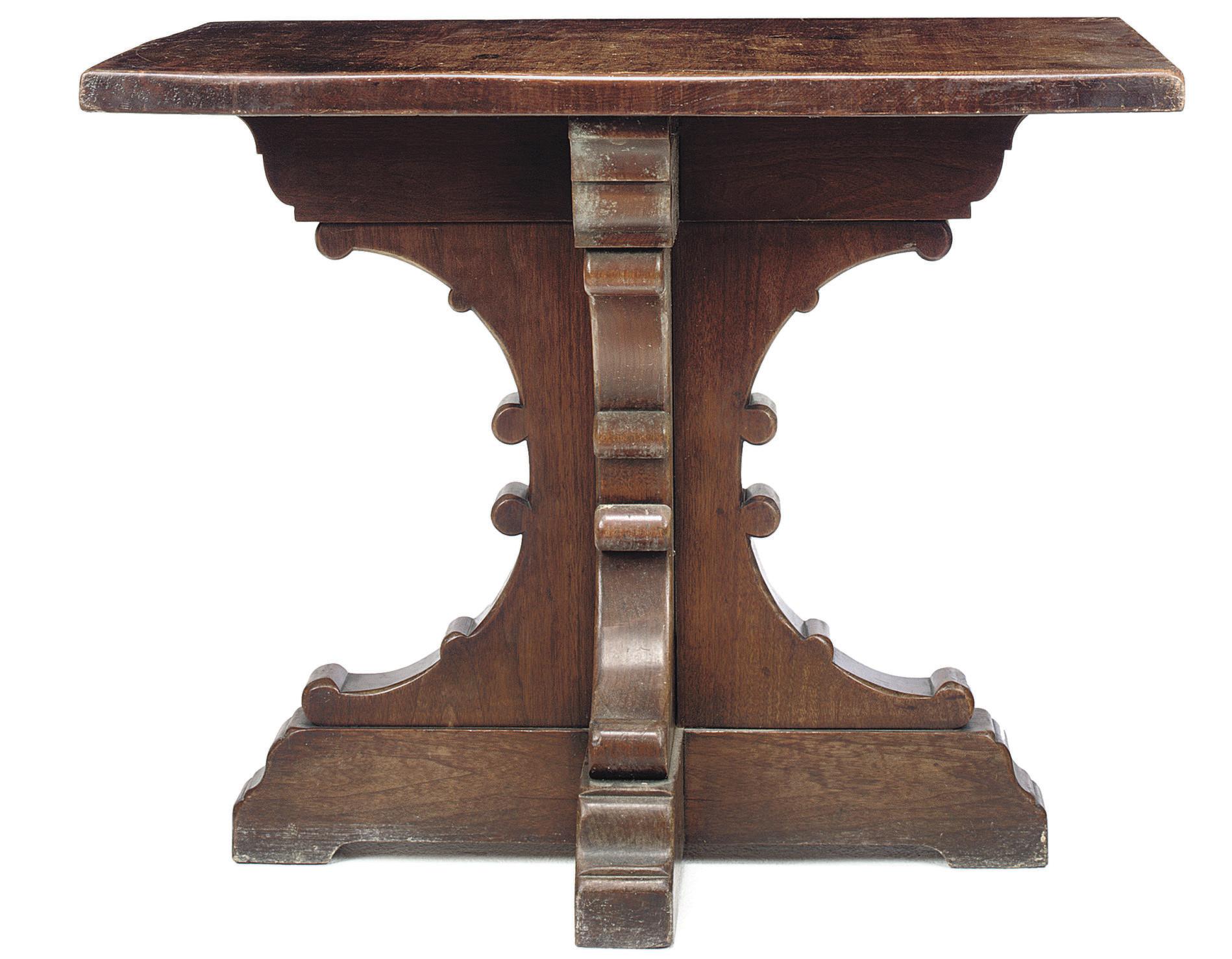 A VICTORIAN WALNUT CENTRE TABL
