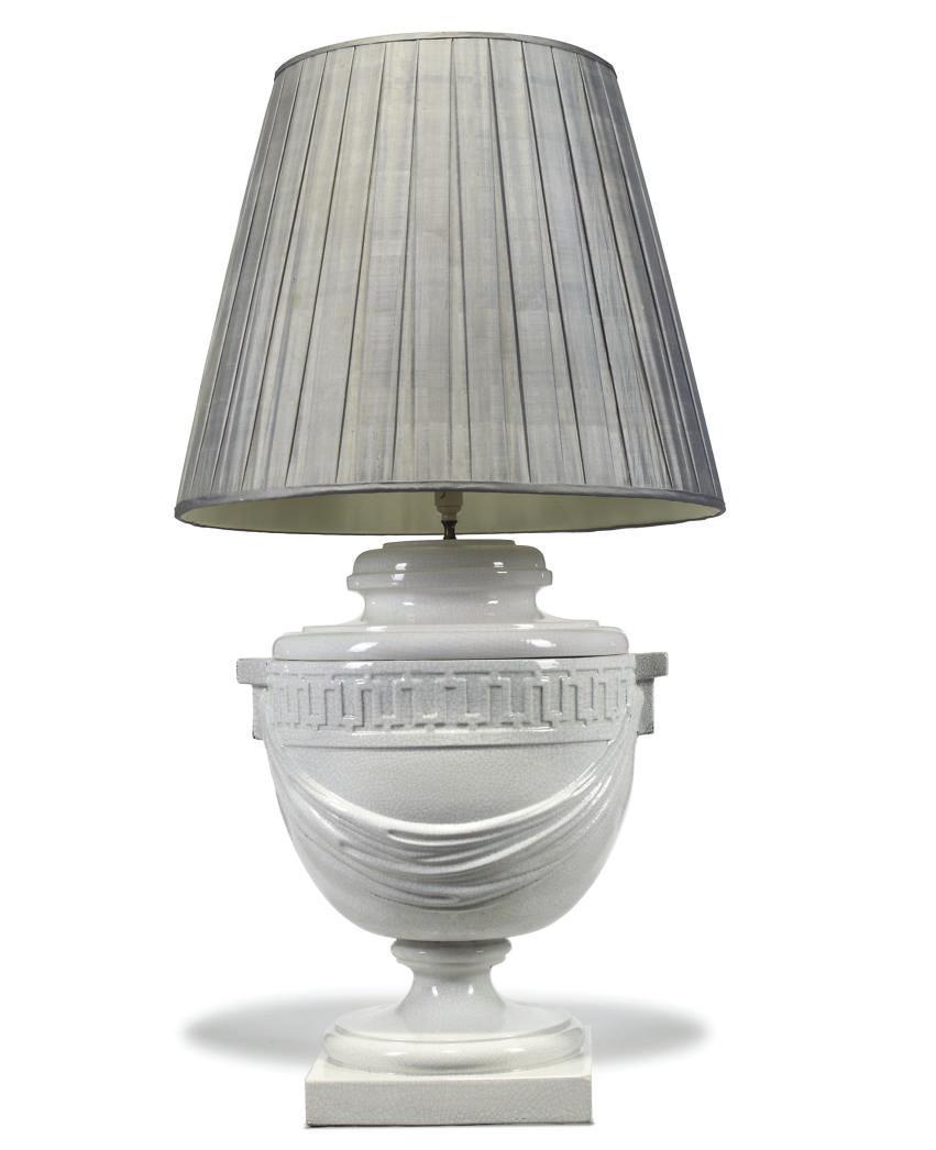 A WHITE-GLAZED POTTERY LAMP