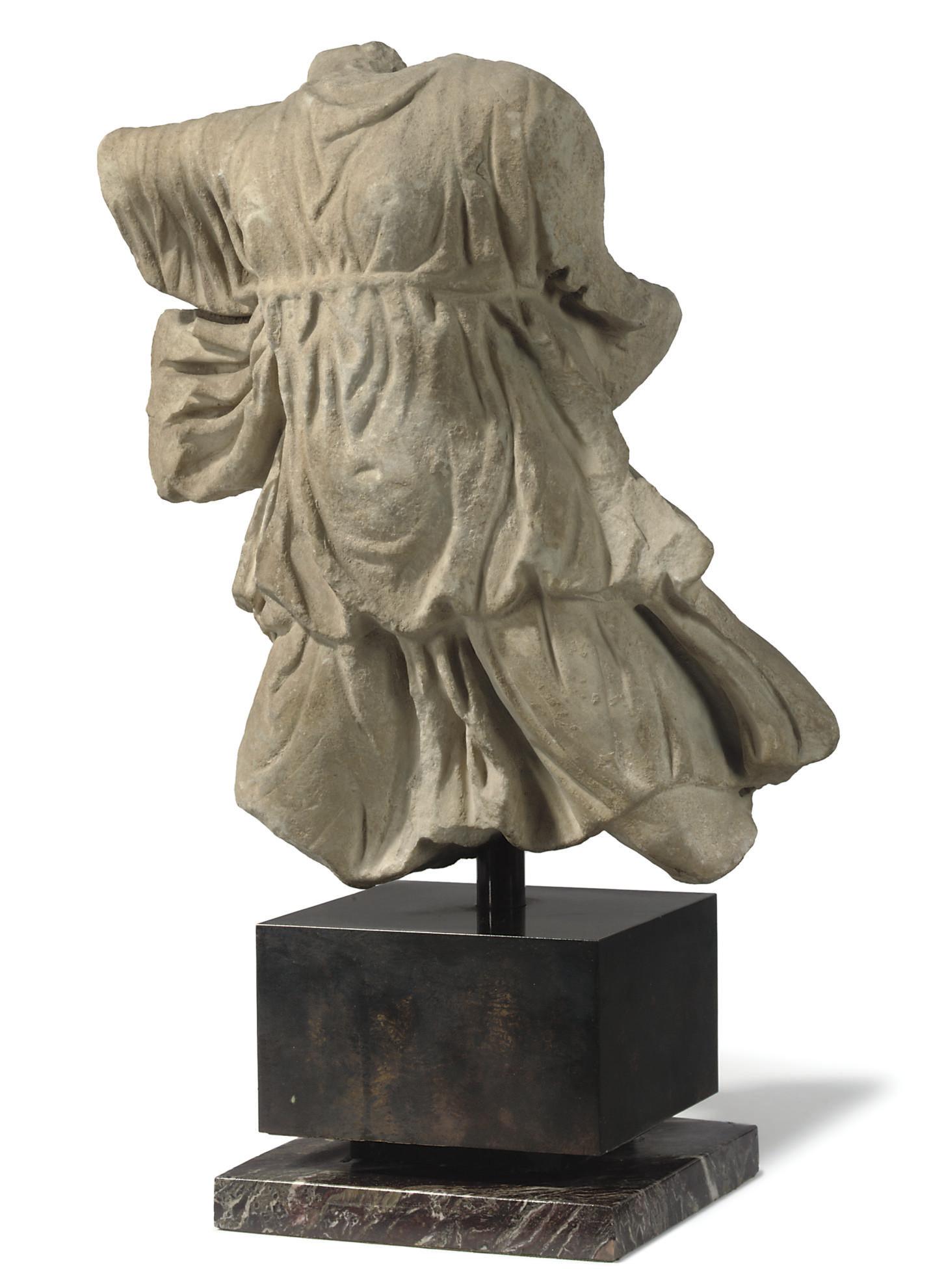 A ROMAN MARBLE TORSO OF ARTEMI