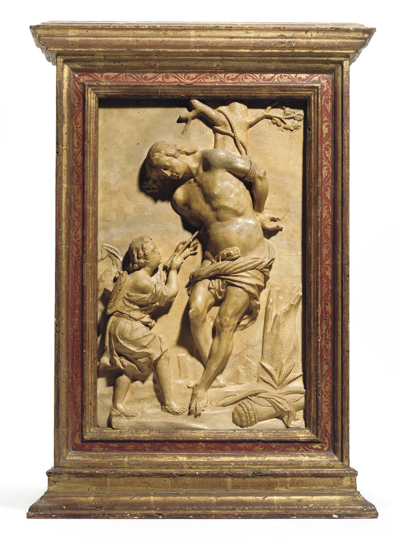 A CARVED ALABASTER RELIEF OF S