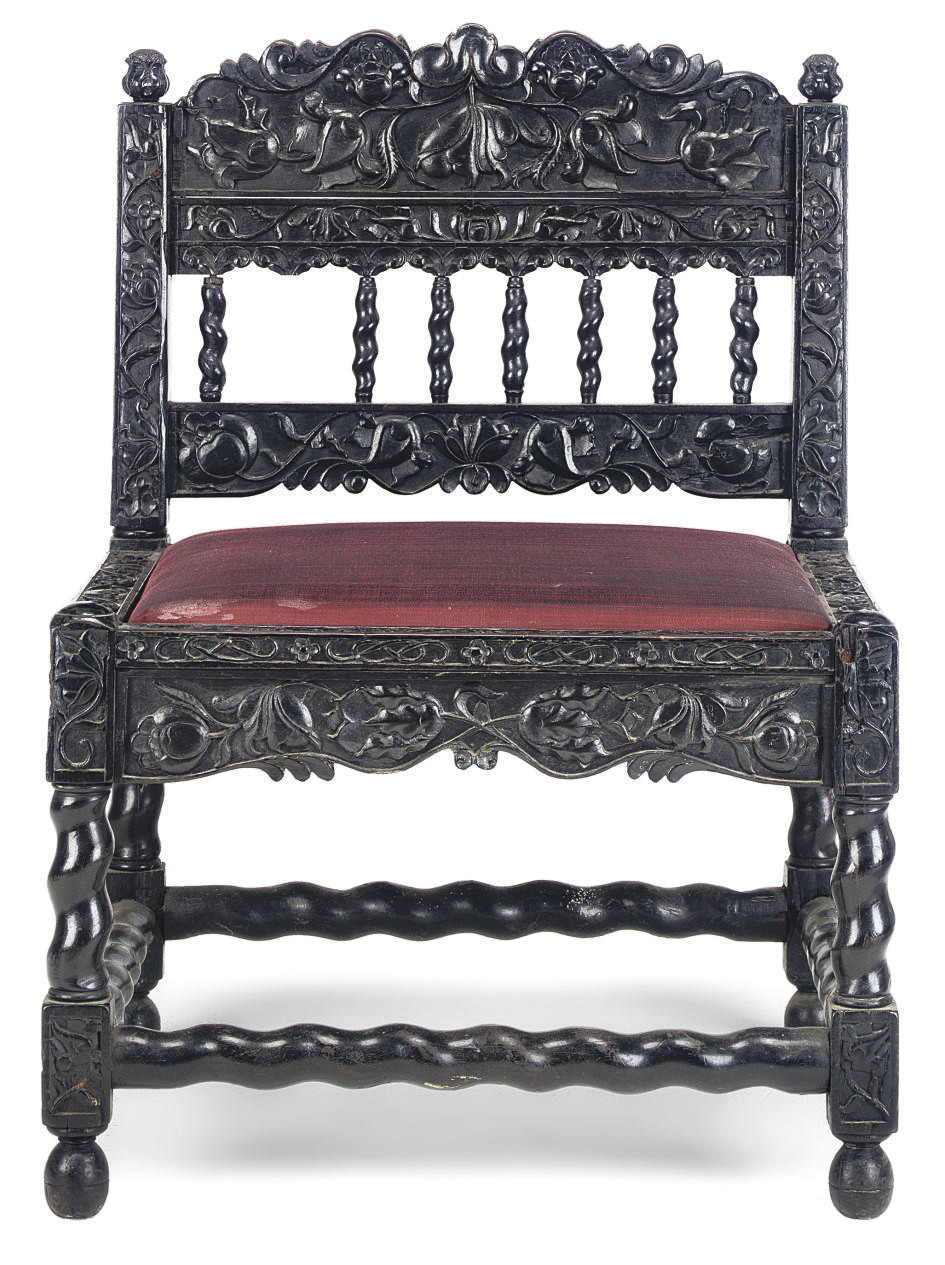 AN INDIAN EBONY LOW CHAIR