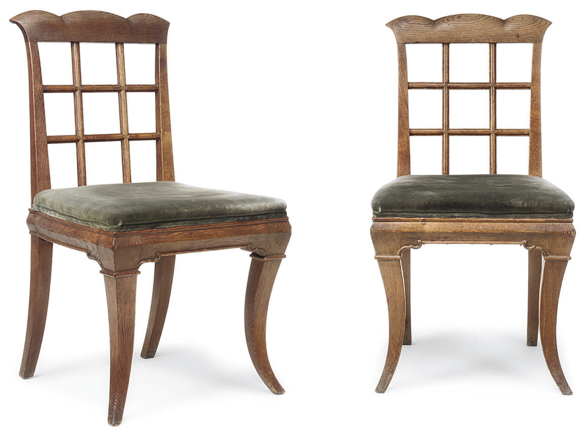 A PAIR OF EDWARDIAN OAK SIDE CHAIRS