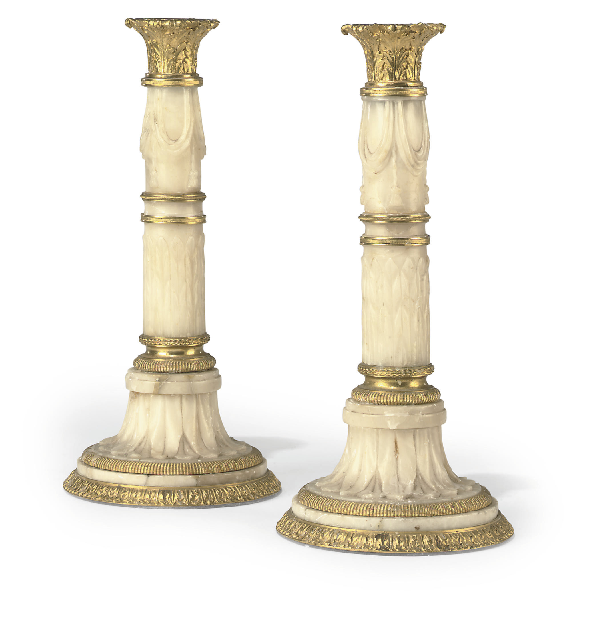 A PAIR OF ITALIAN ORMOLU-MOUNTED ALABASTER CANDLESTICKS