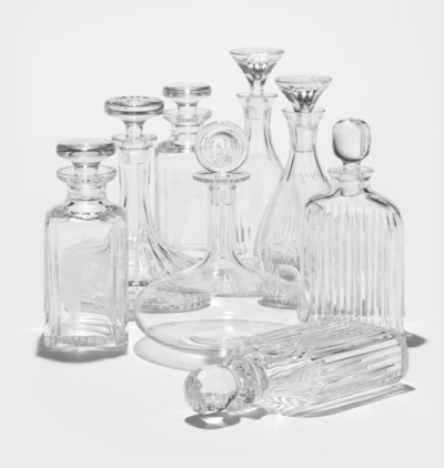 EIGHT CLEAR GLASS DECANTERS AN