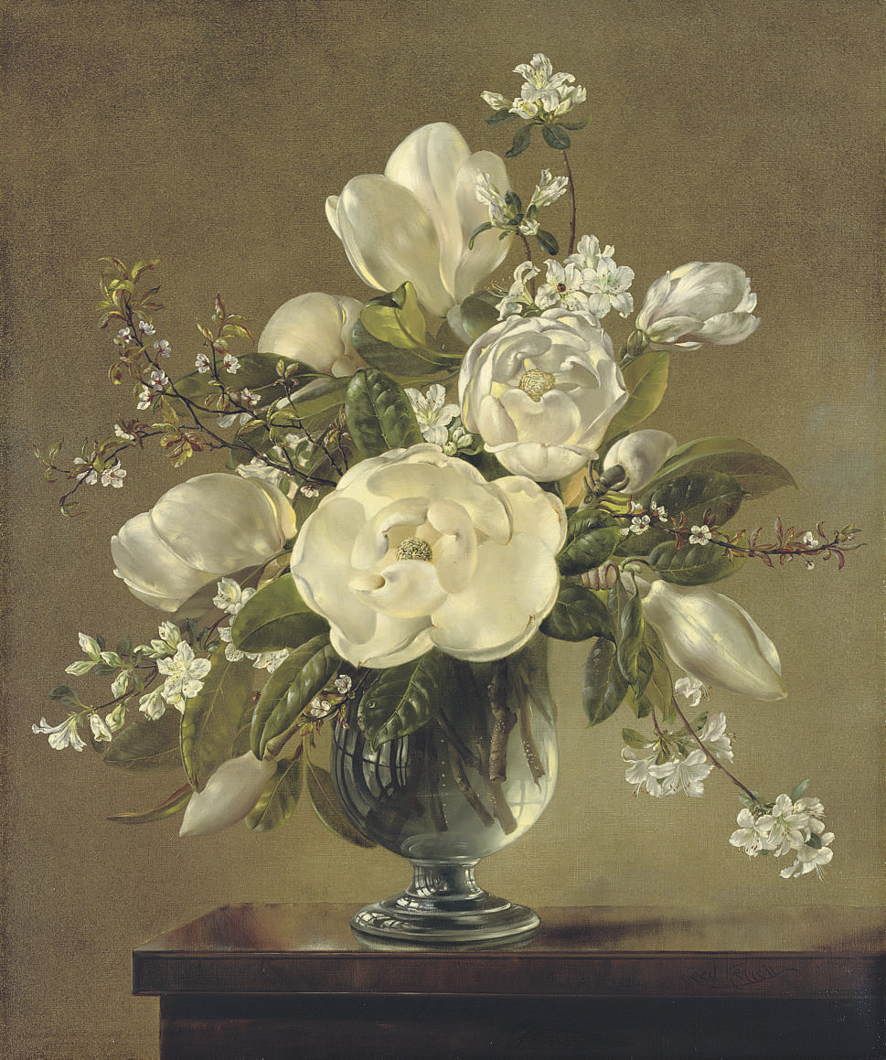 White blossom and magnolia in a glass vase