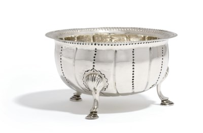 A GEORGE II IRISH SILVER SUGAR