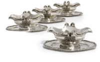 A SET OF FOUR FRENCH SILVER SAUCEBOATS, STAND AND LINERS