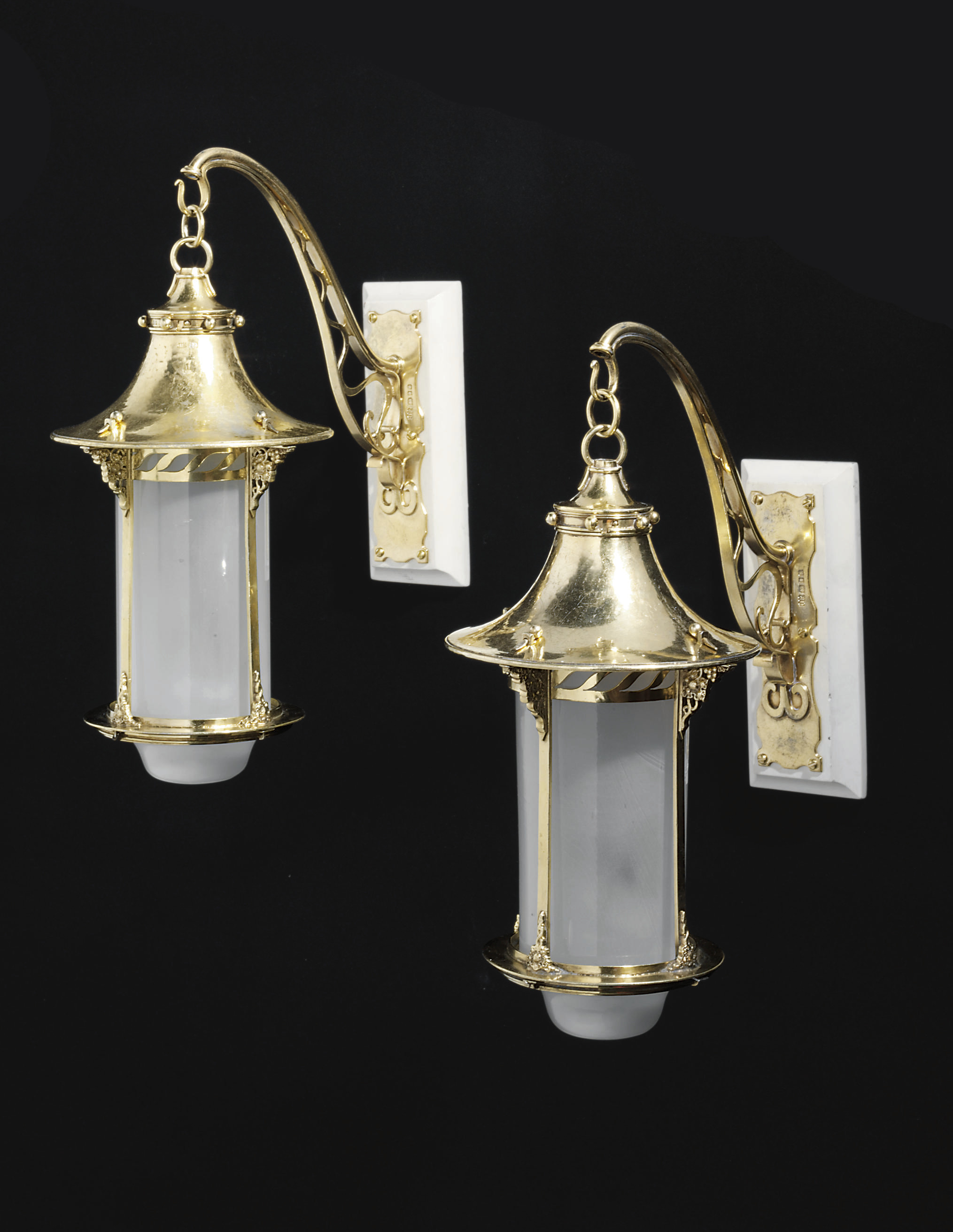 AN IMPORTANT PAIR OF GEORGE V SILVER-GILT LANTERNS