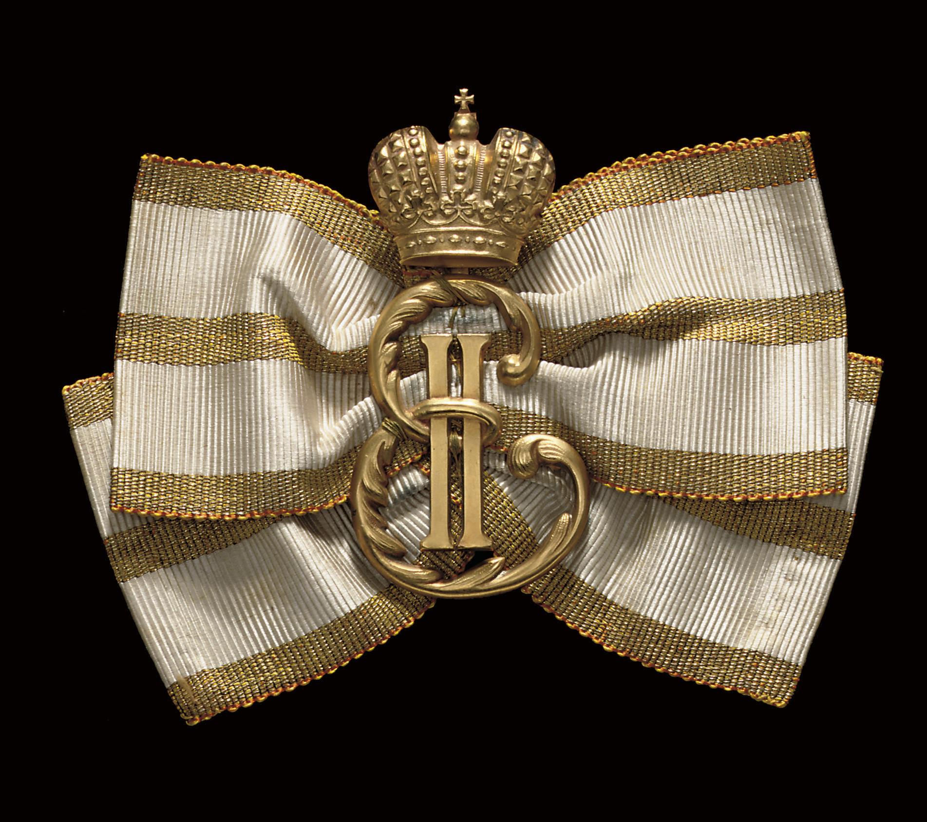 Gold monogram for rewarding pu