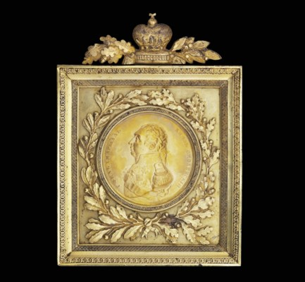 A framed medallion of Field-Ma