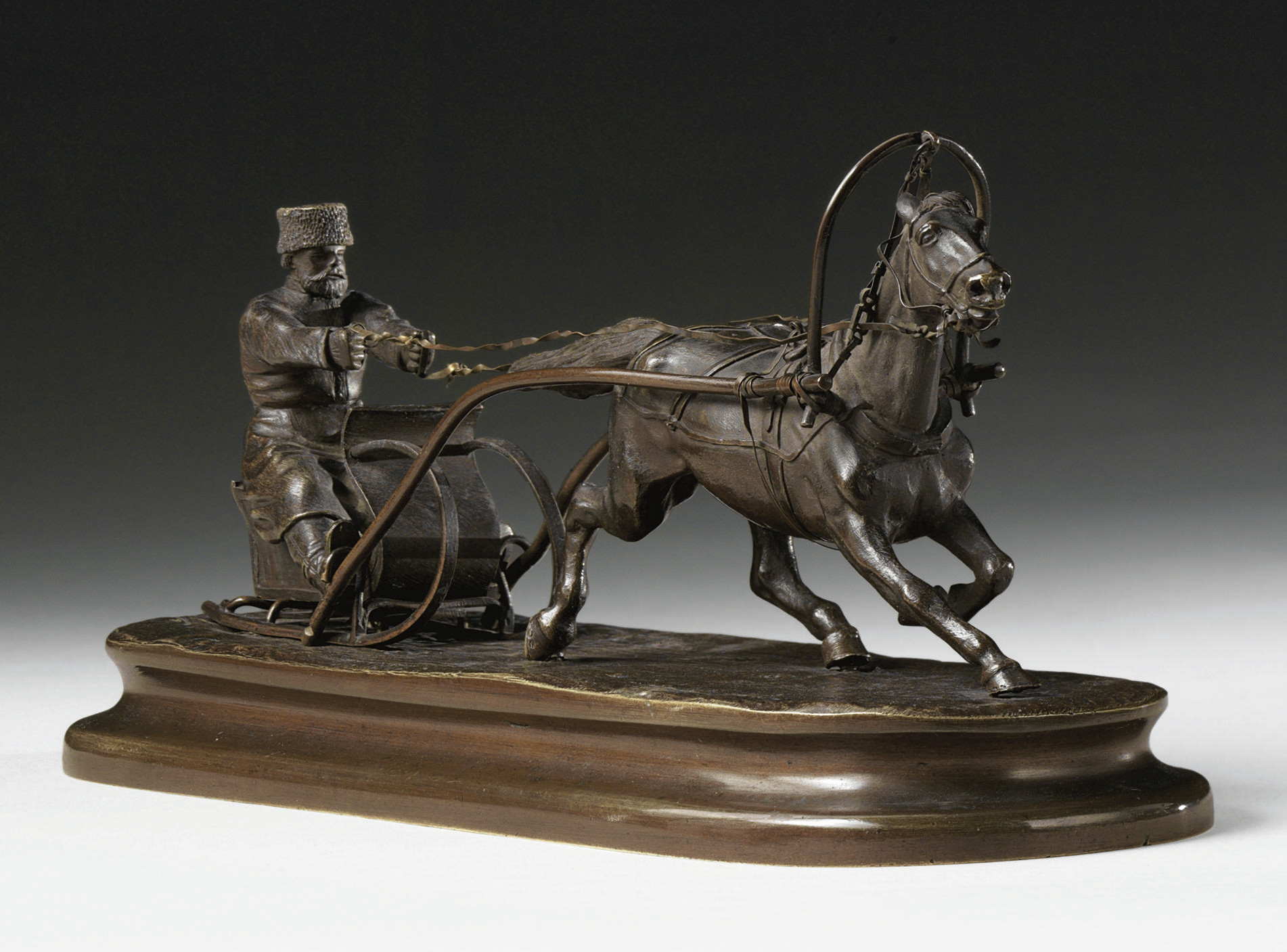 A bronze group of a horse pass