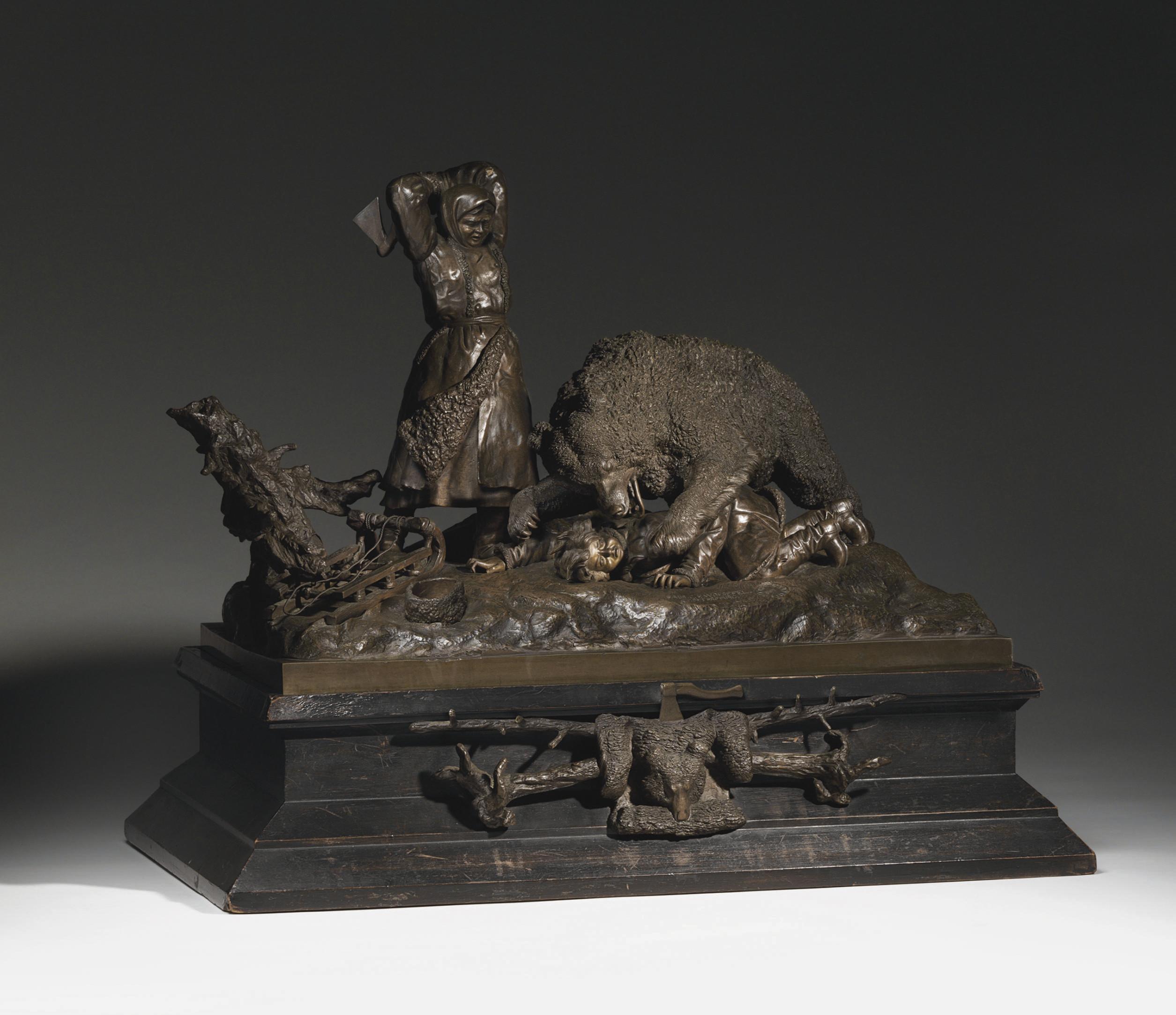 A bronze group of a bear attac