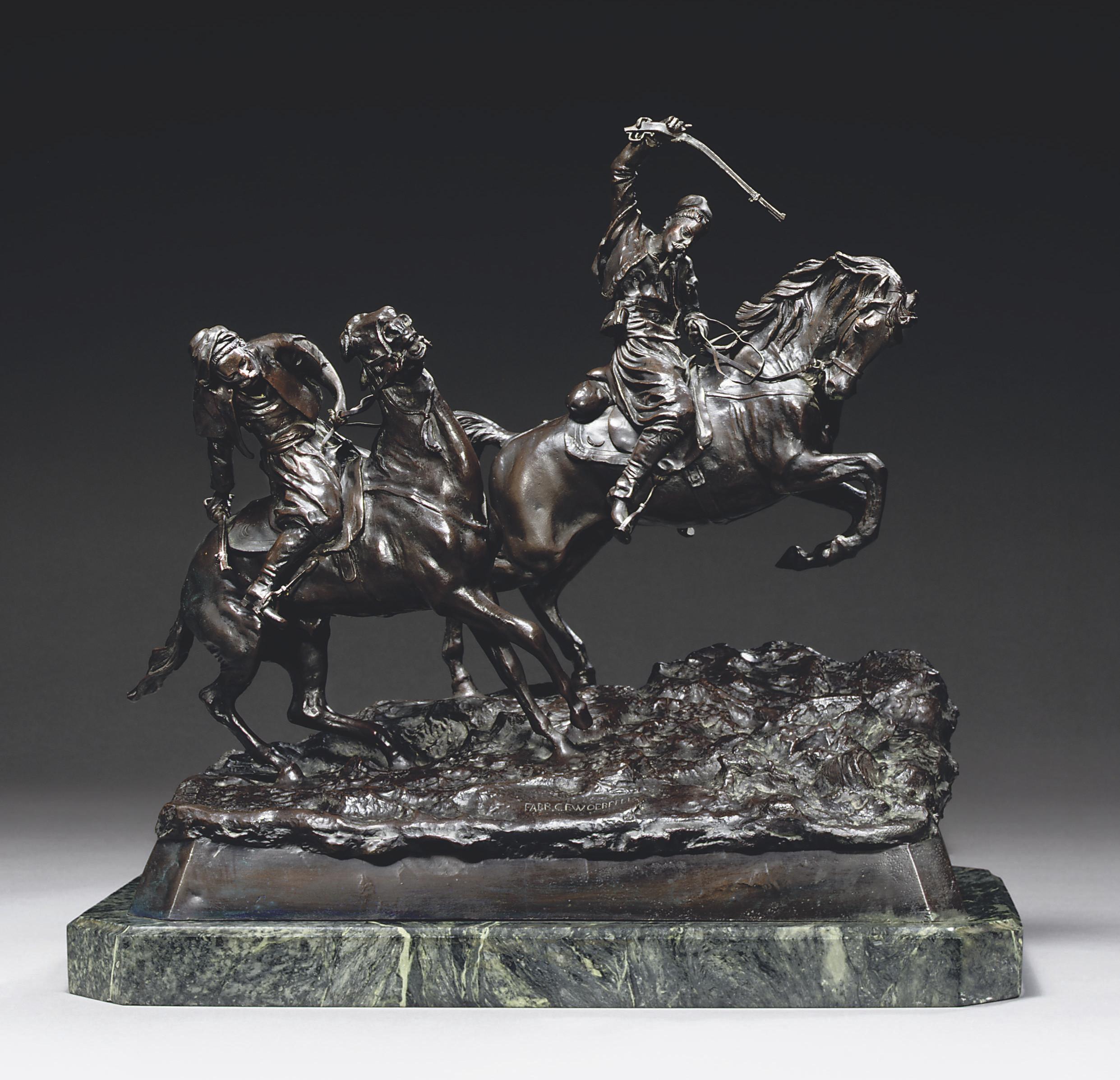 A bronze group of two horsemen