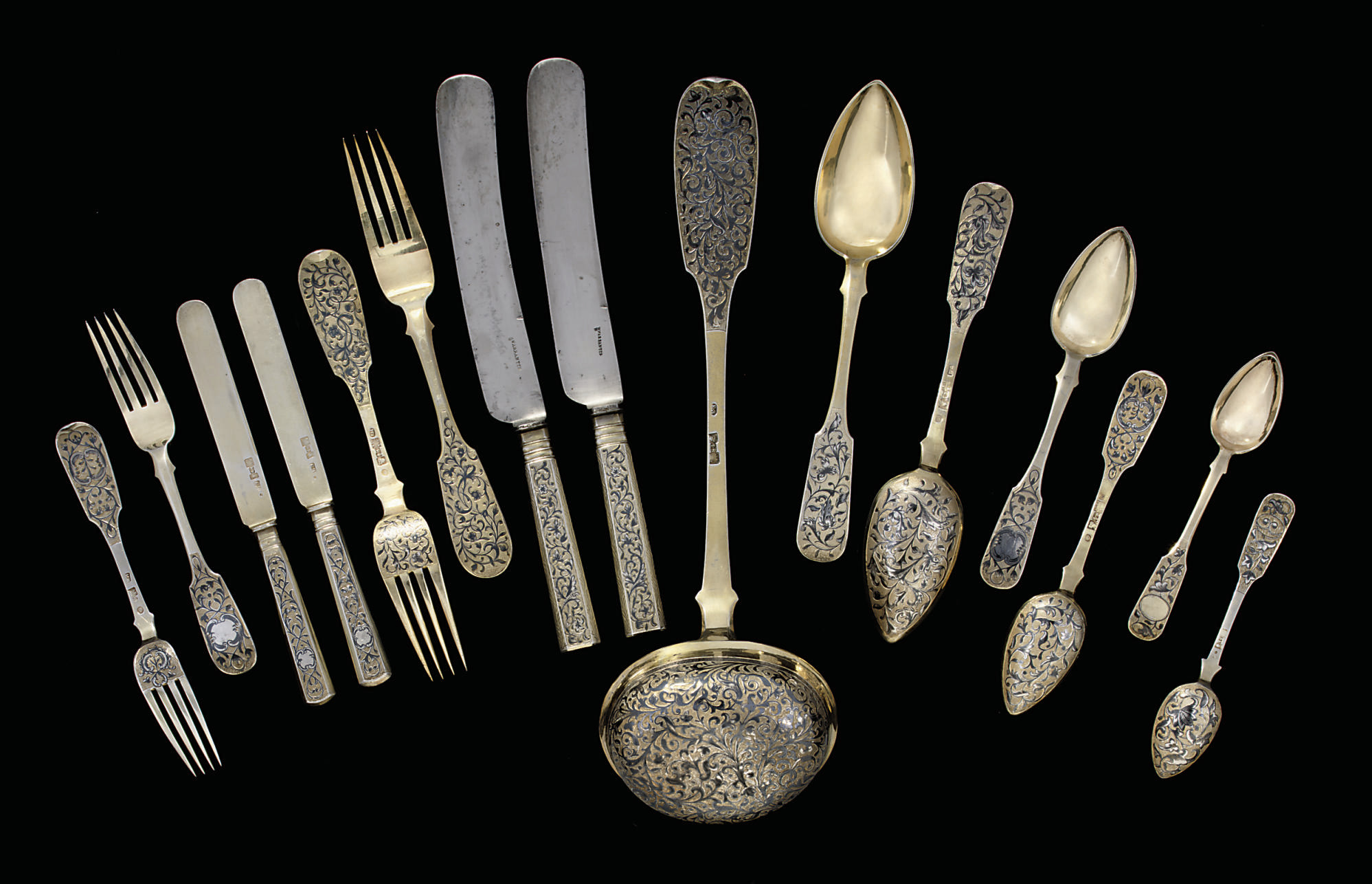 A composite silver-gilt and ni