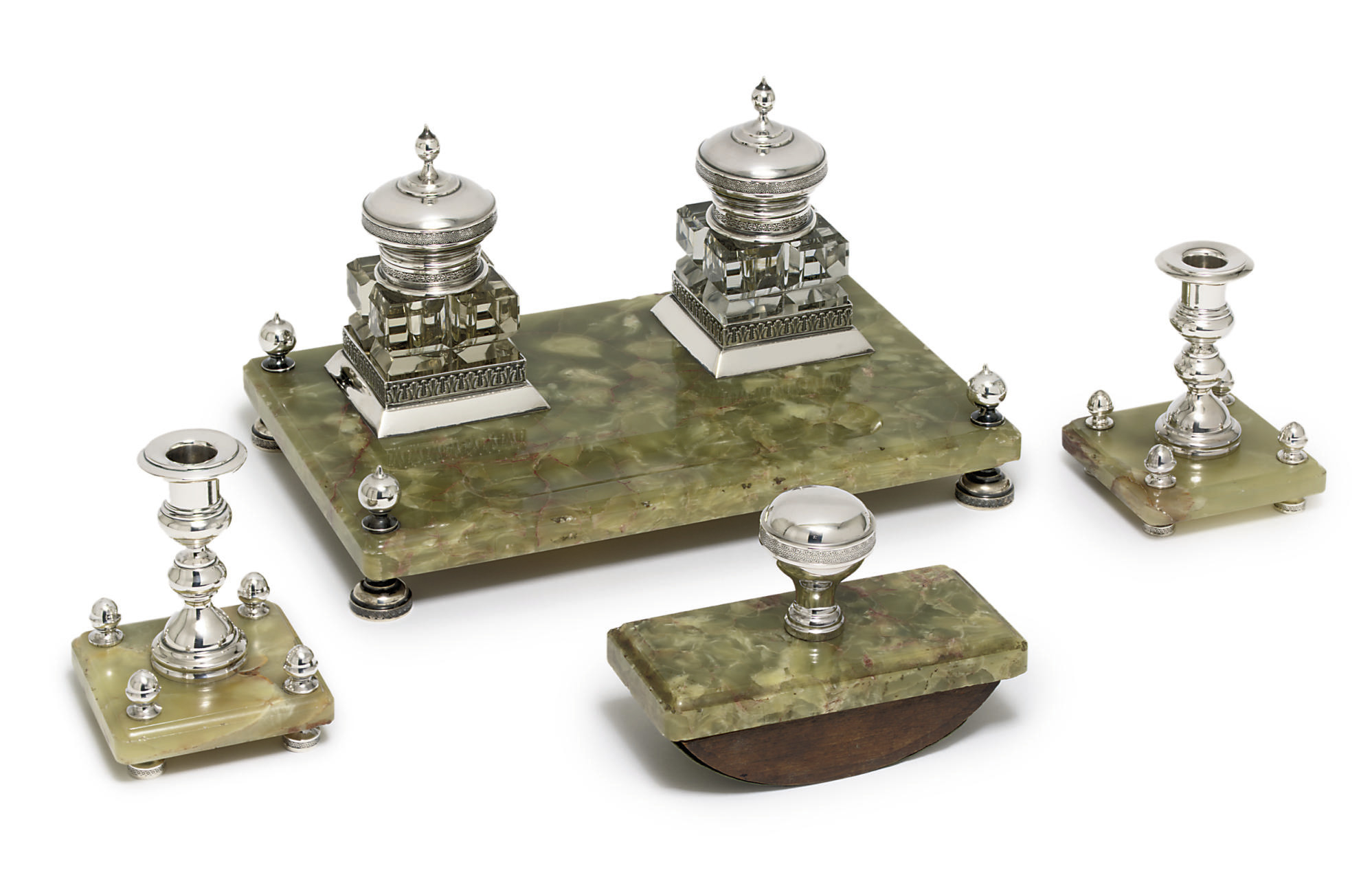 A four-piece silver-mounted ma