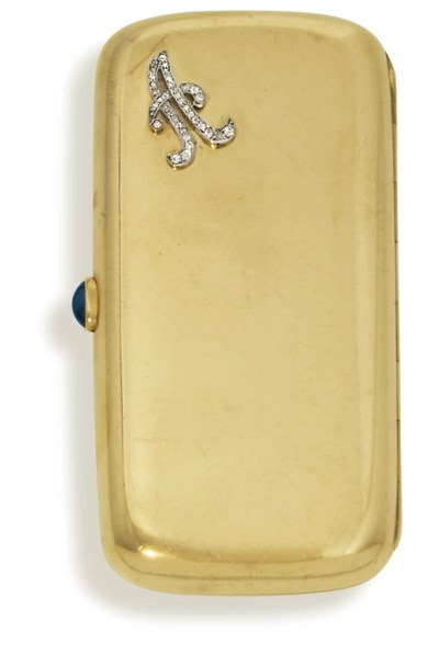 A small jewelled gold cigarett