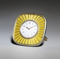 A silver-gilt and gold-mounted guilloché enamel sunburst clock