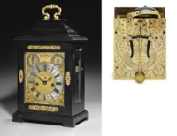 A Queen Anne gilt-brass mounted ebony striking eight day table clock