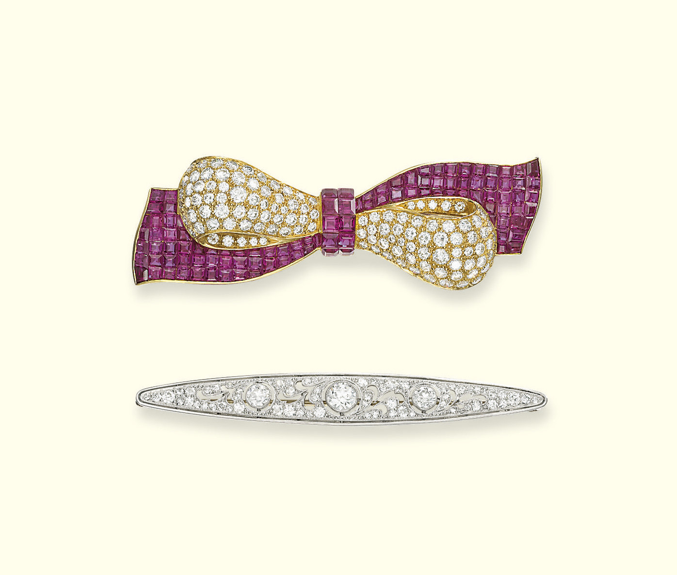 A RUBY AND DIAMOND BROOCH AND