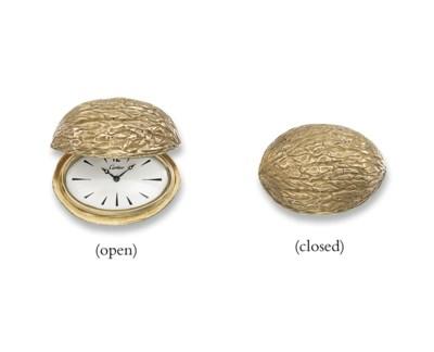 AN UNUSUAL 'WALNUT' CLOCK, BY