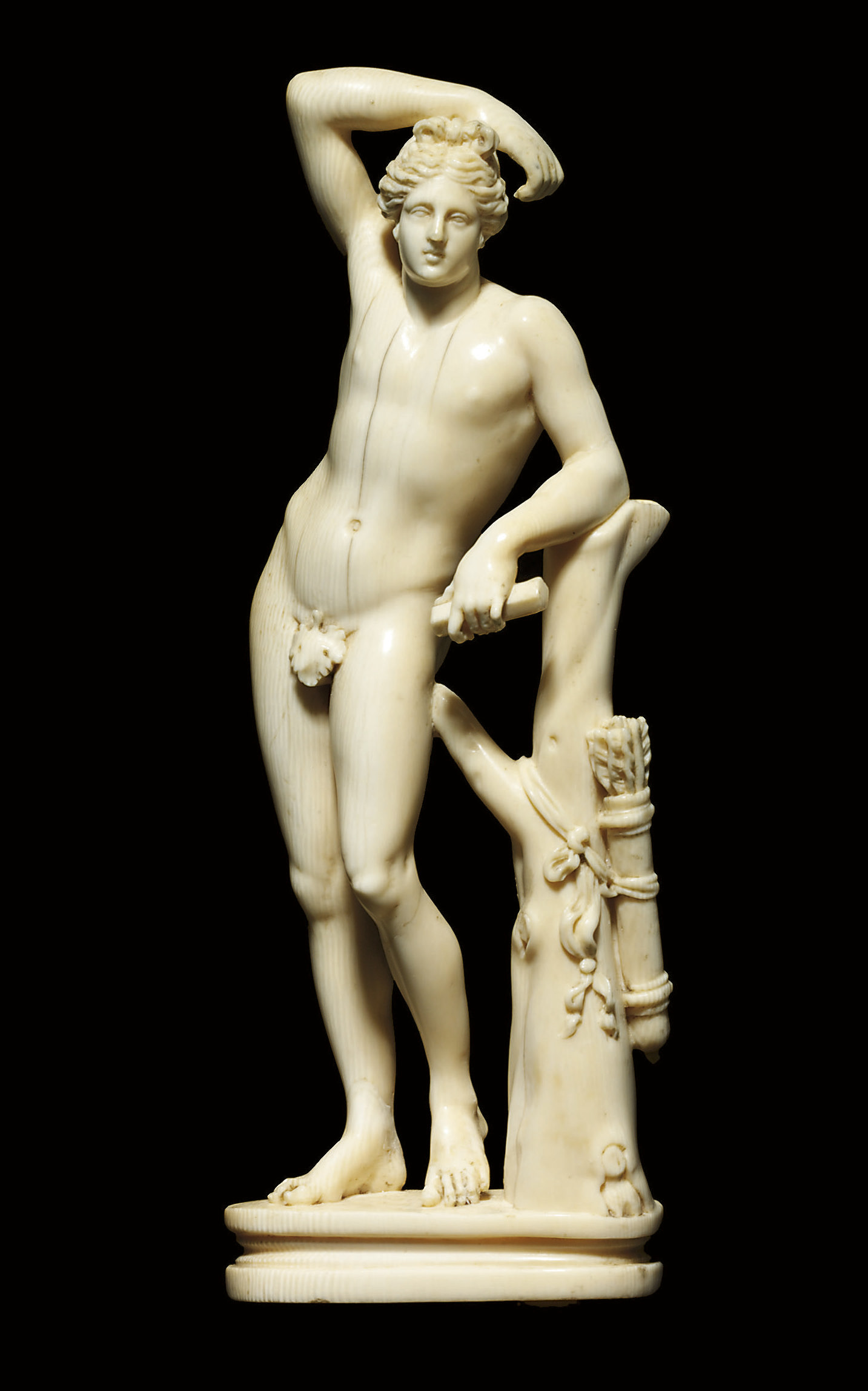 A CARVED IVORY FIGURE OF THE A