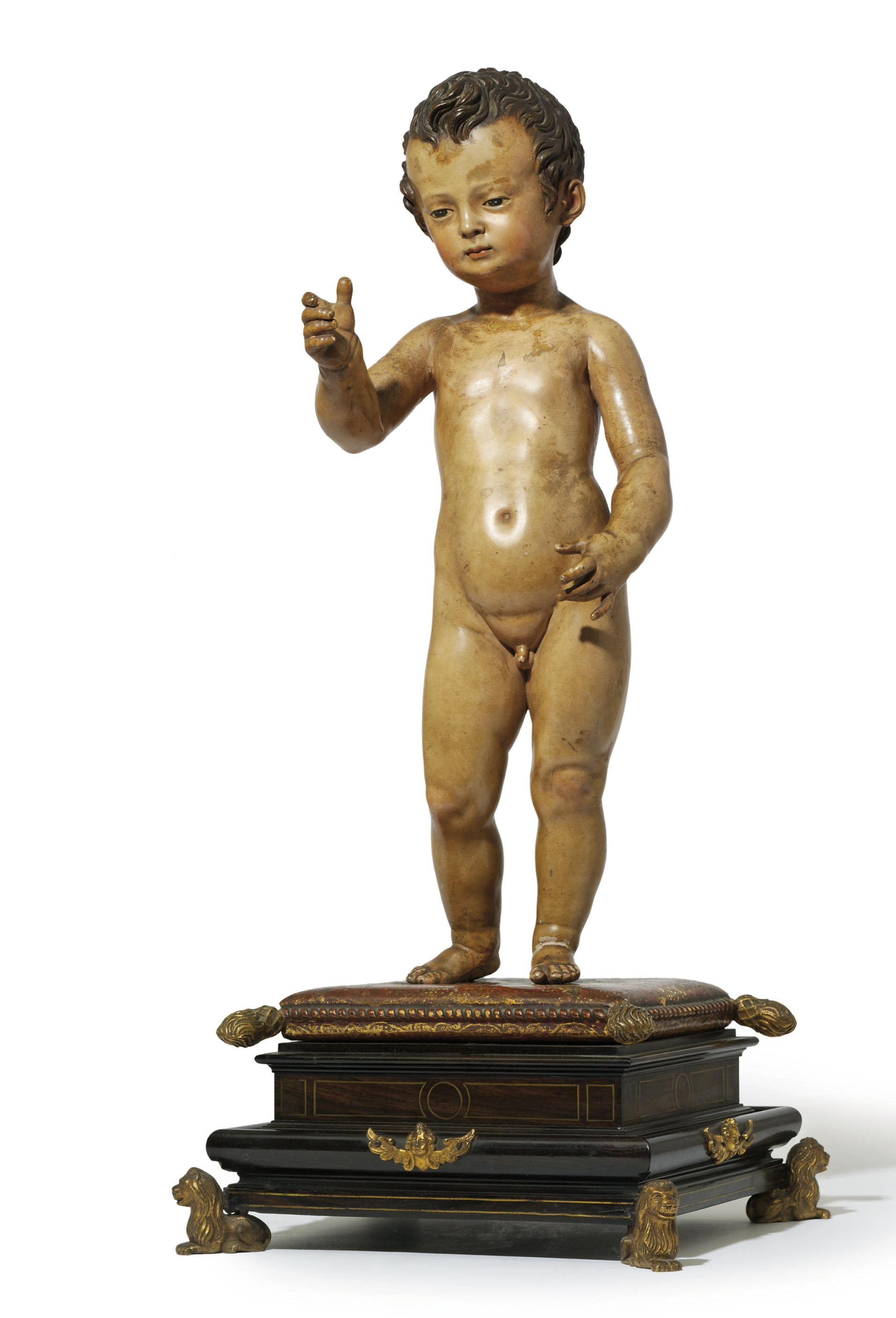 A POLYCHROME LEAD FIGURE OF TH