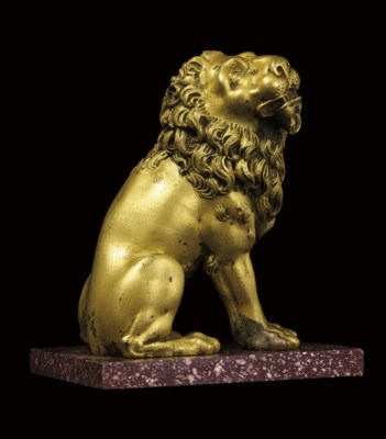 A GILT-BRONZE MODEL OF A SEATE
