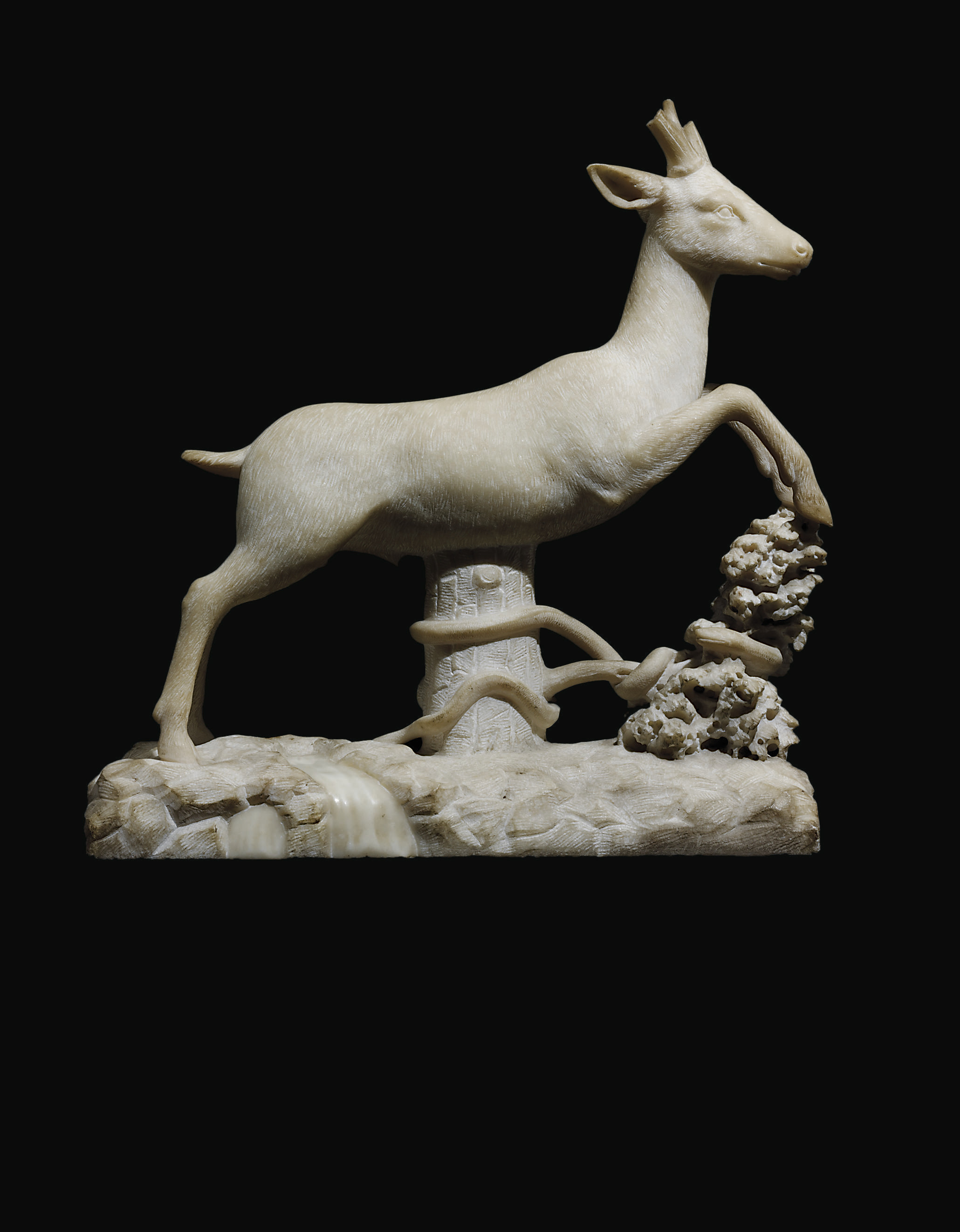 A CARVED MARBLE MODEL OF A LEA