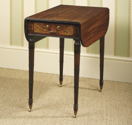 A REGENCY EBONY-INLAID MAHOGAN