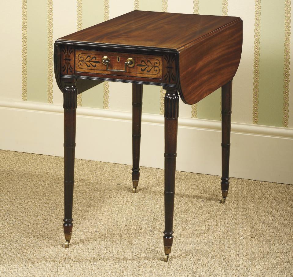 A REGENCY EBONY-INLAID MAHOGANY PEMBROKE TABLE