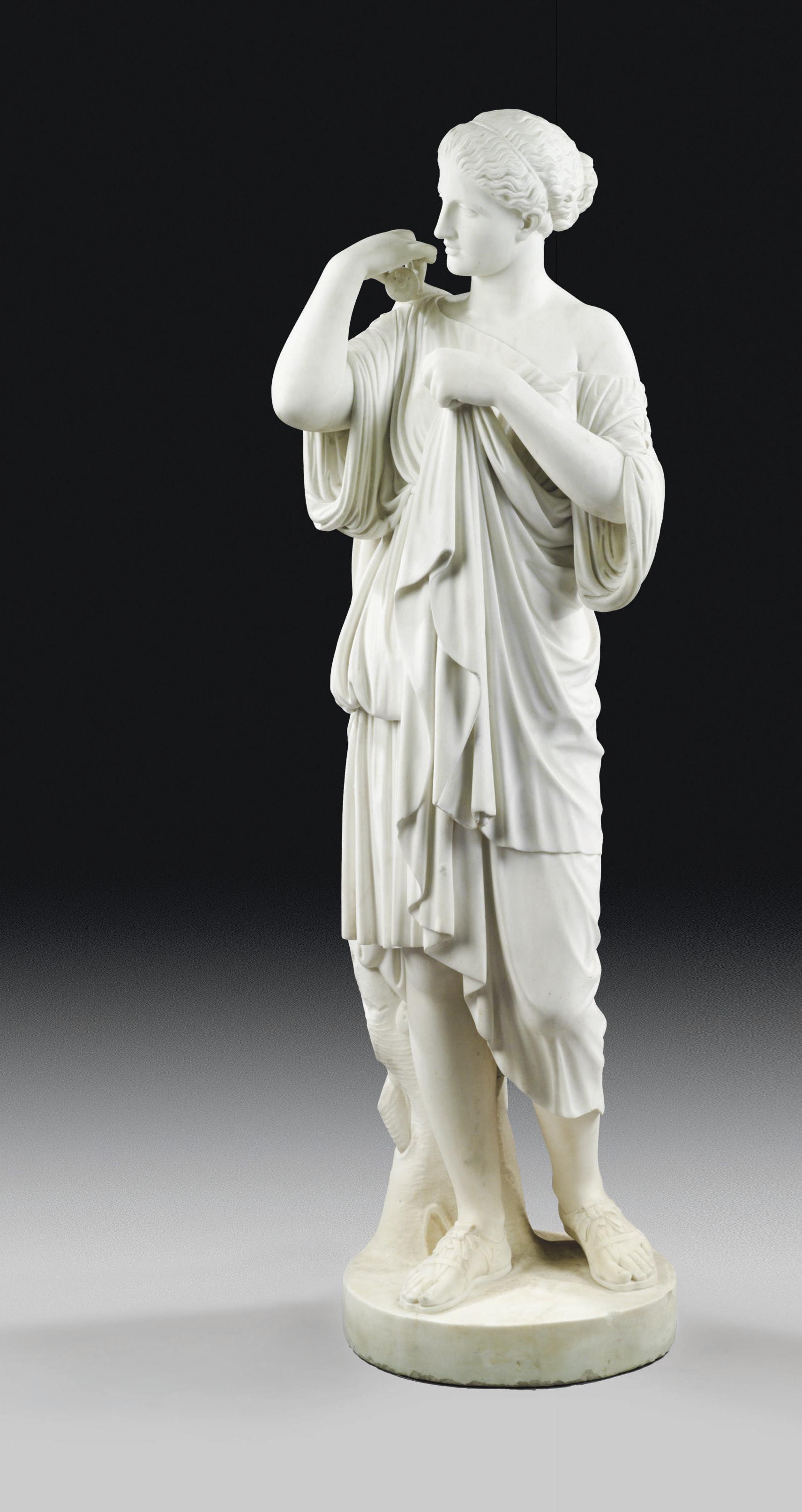 AN ITALIAN WHITE MARBLE FIGURE OF DIANA OF GABIES