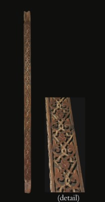 AN UMAYYAD CARVED AND PAINTED