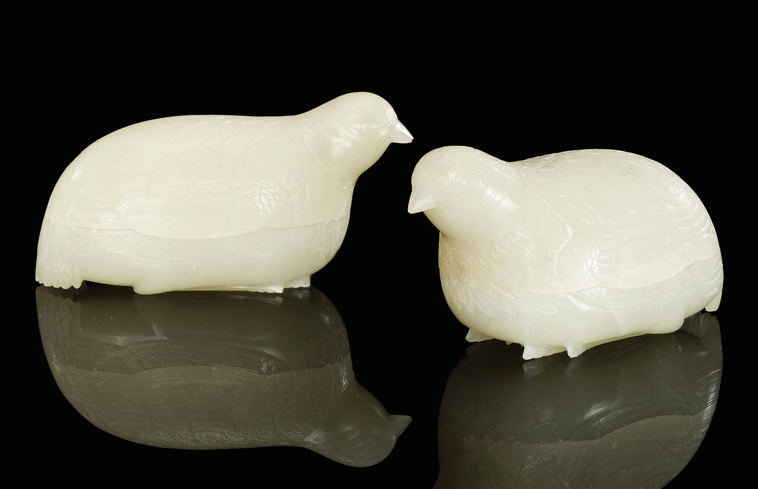 A PAIR OF FINELY CARVED WHITE