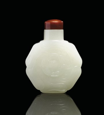 A FINELY CARVED WHITE JADE SNU