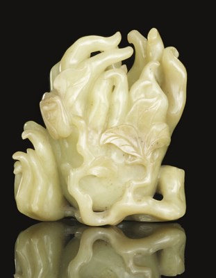 A YELLOW JADE CARVING OF A FIN