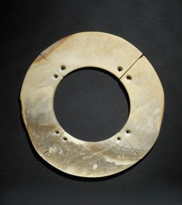 A FOUR-SEGMENT JADE DISC, YUAN
