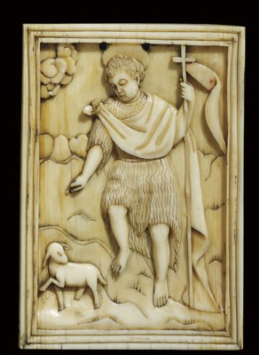 A CARVED IVORY RELIEF OF ST JO