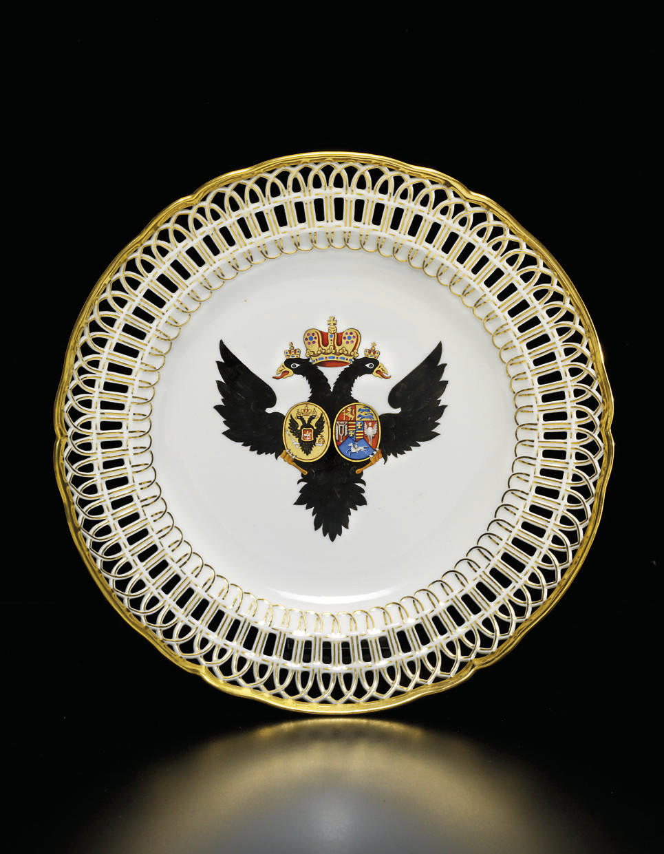 A porcelain armorial dinner pl
