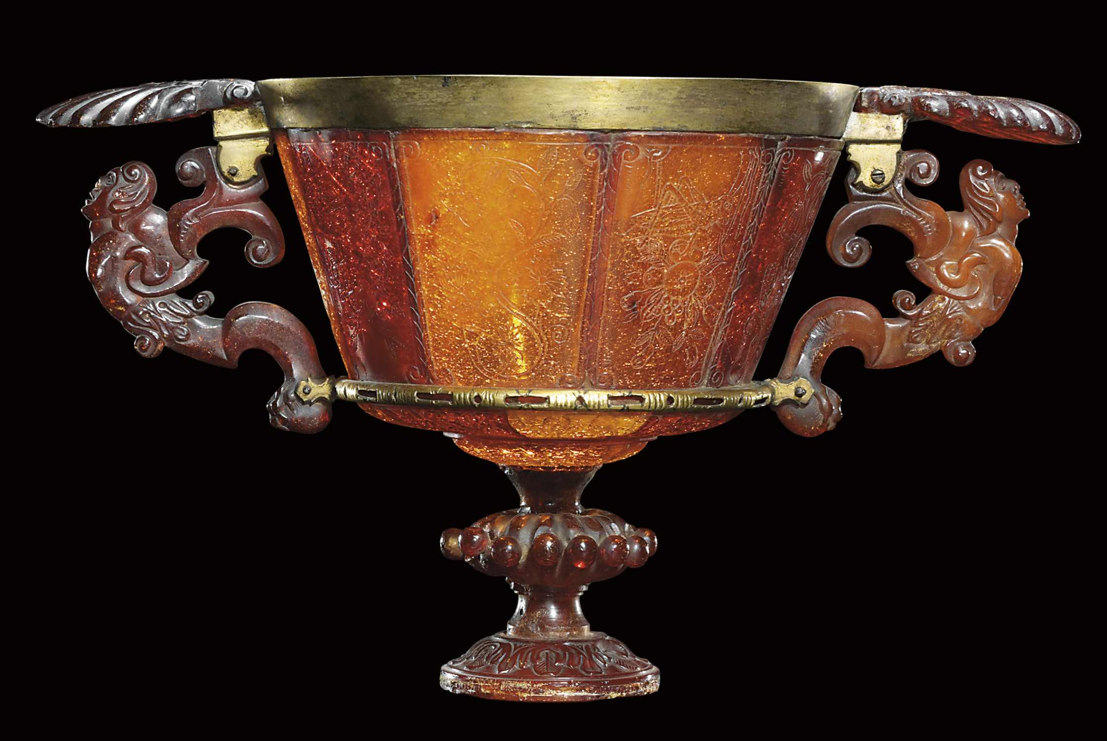 A GILT-BRASS MOUNTED AMBER TWO