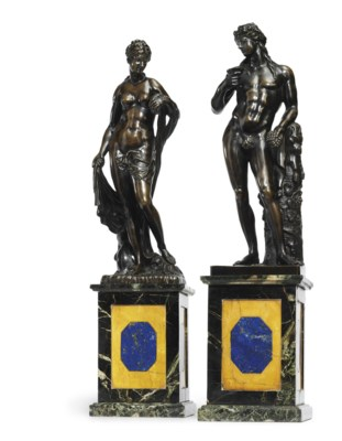 A PAIR OF BRONZE FIGURES OF AM