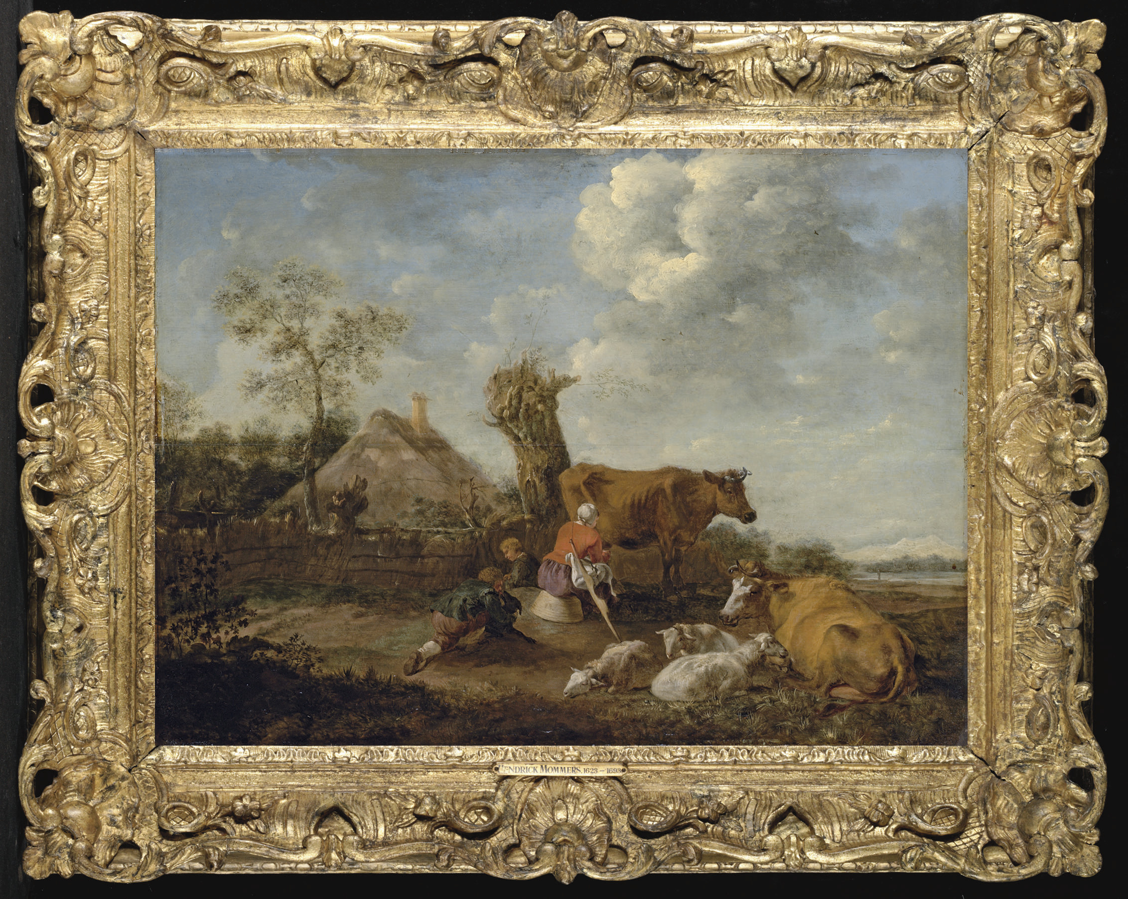 A pastoral landscape with a milkmaid milking beside a cottage