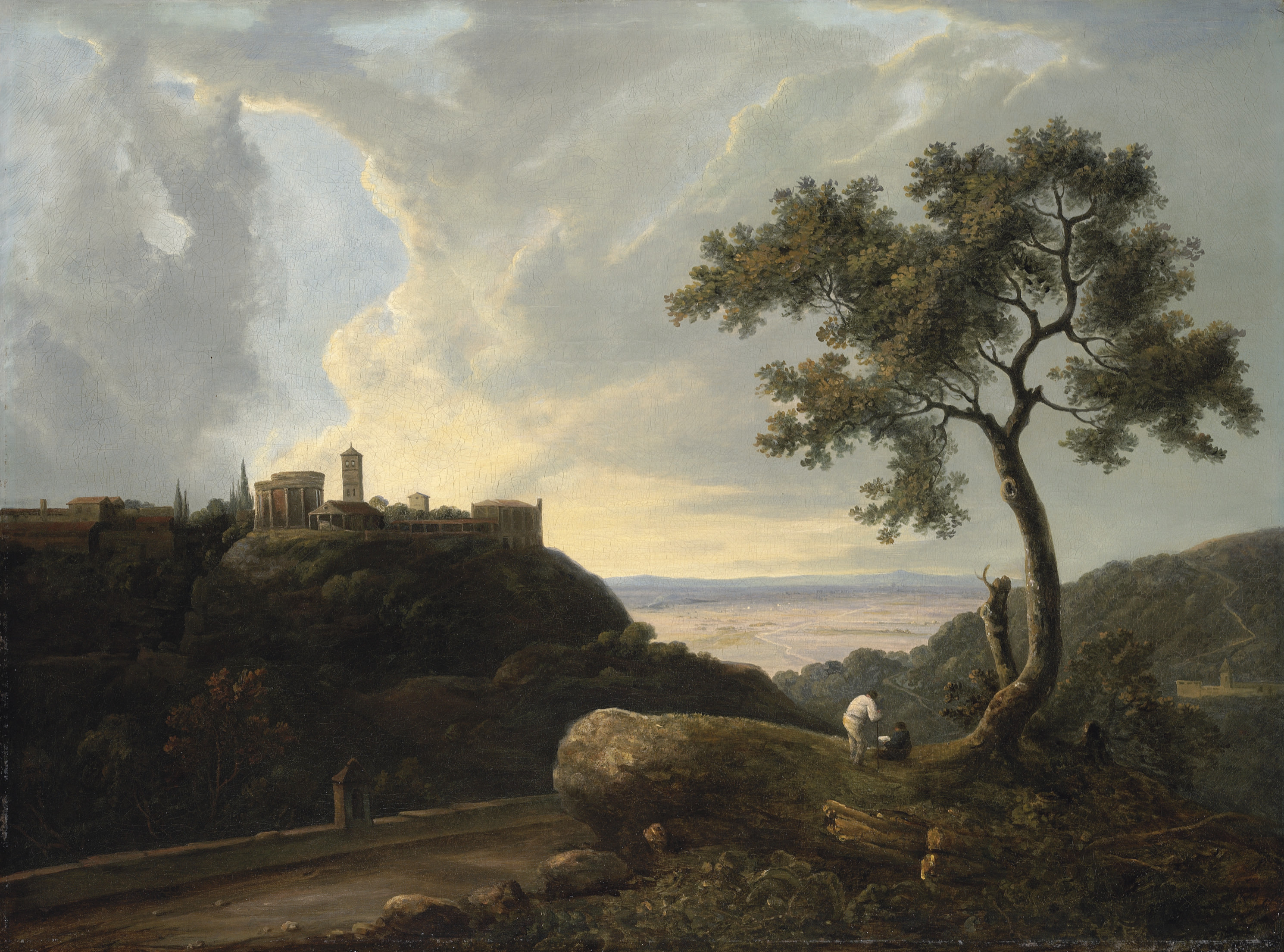 An extensive classical landscape with an artist sketching the Temple of the Sibyl and the Temple of Tiburtius, Tivoli