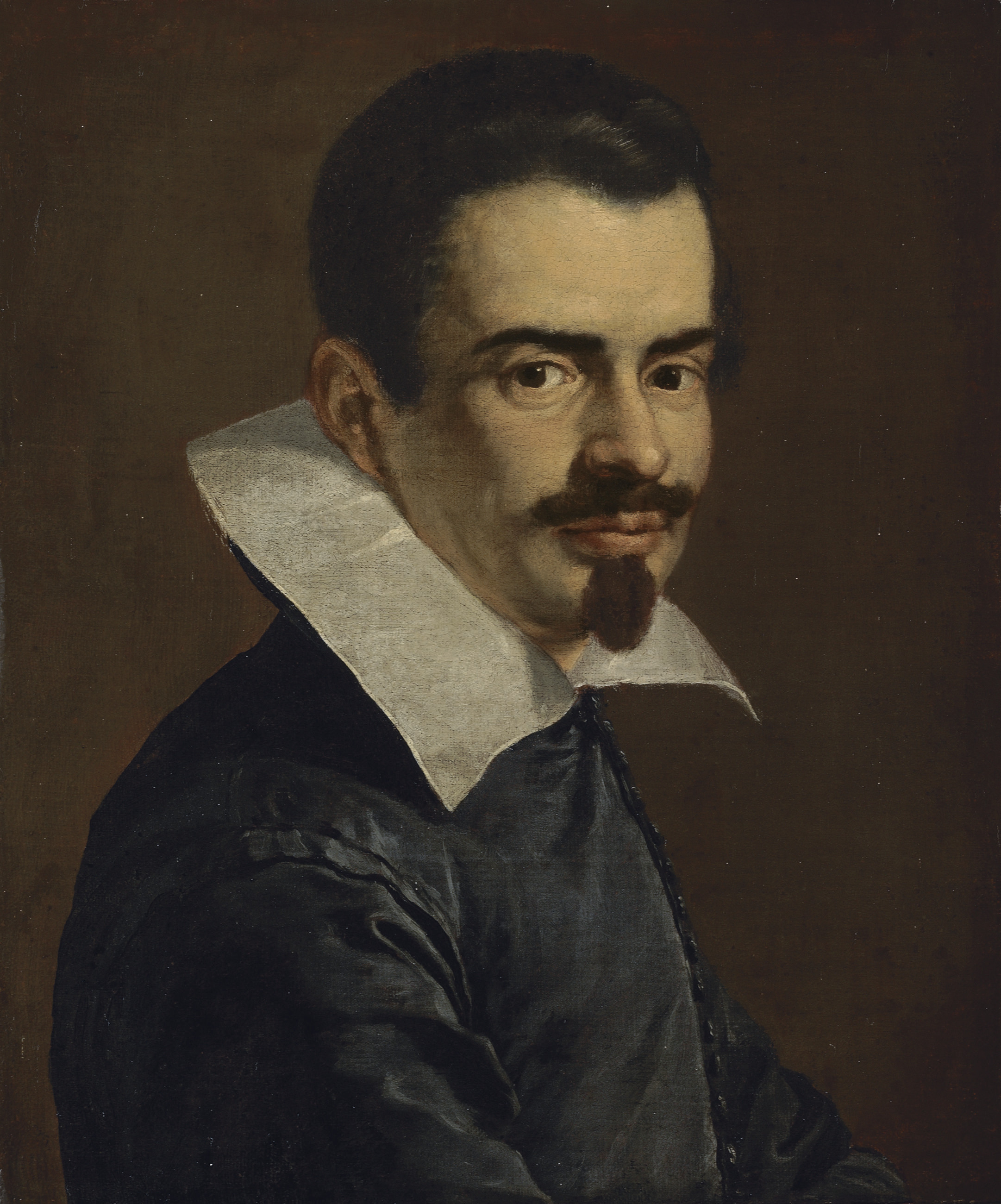 Portrait of a gentleman, bust-length, in a black doublet with a white collar