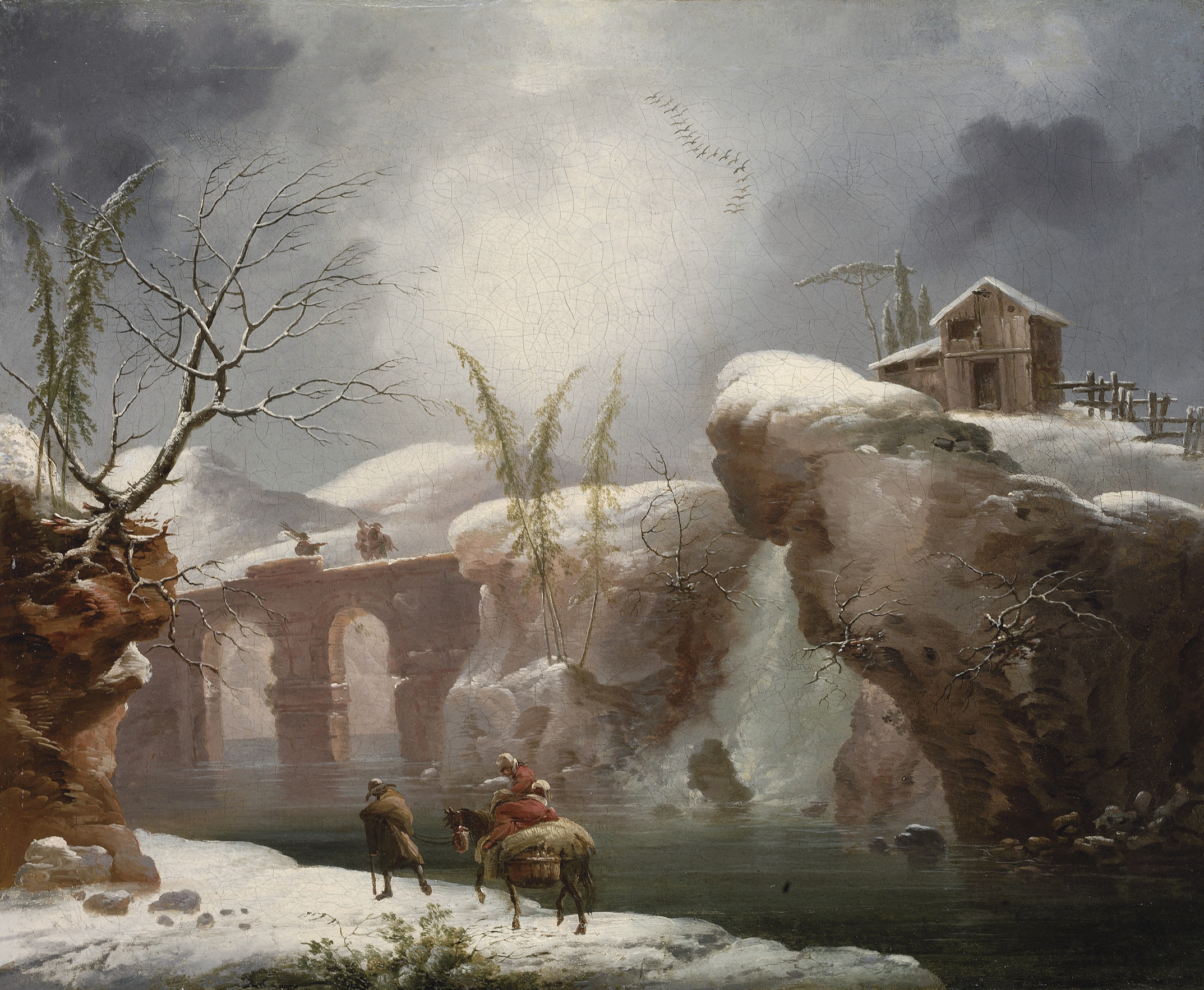 A winter landscape with travellers by a river