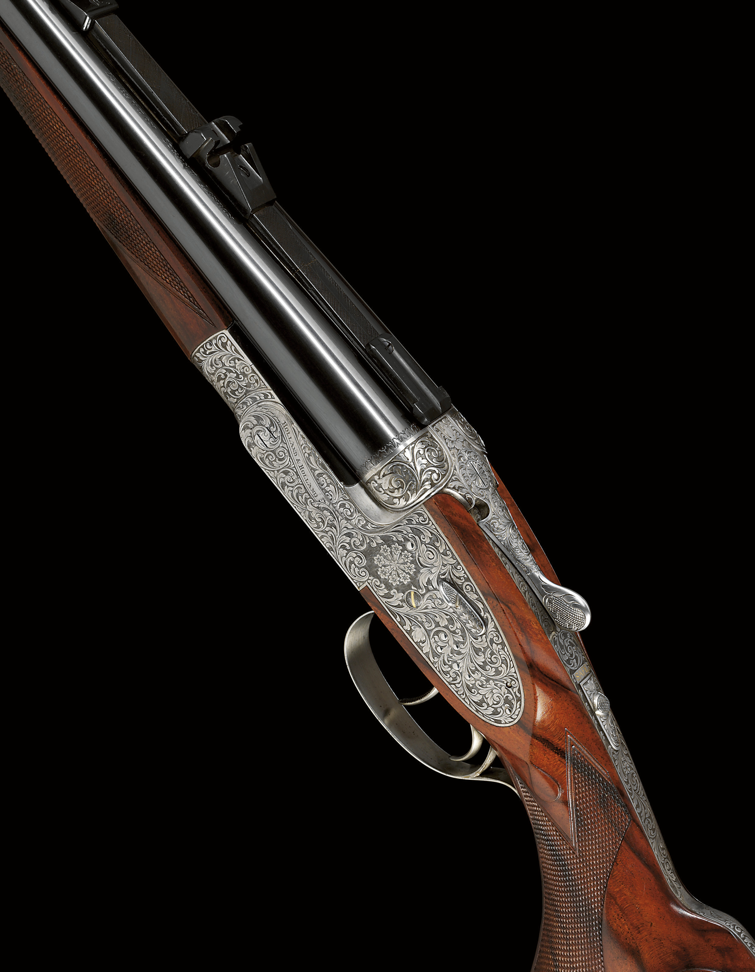 AN EXCEPTIONALLY FINE .375 MAGNUM RIMLESS KEN HUNT ENGRAVED 'MODELE DE LUXE' DOUBLE-BARRELLED SIDELOCK EJECTOR RIFLE BY HOLLAND & HOLLAND, NO. 35448