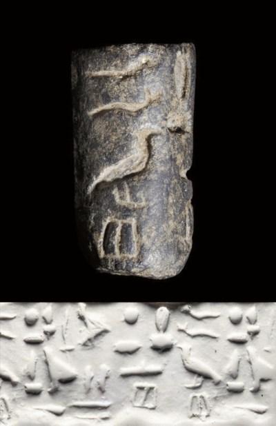 AN EGYPTIAN STEATITE CYLINDER