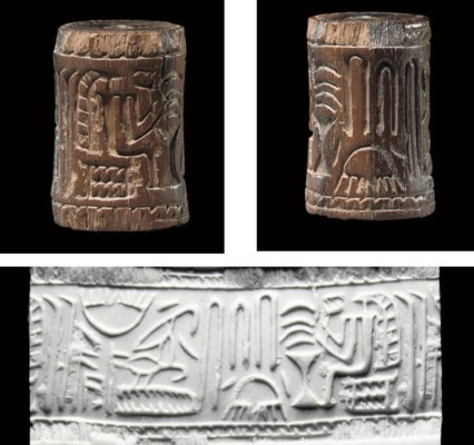 AN EGYPTIAN WOOD CYLINDER SEAL