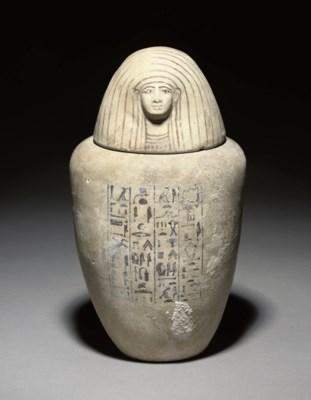 AN EGYPTIAN POTTERY HUMAN-HEAD