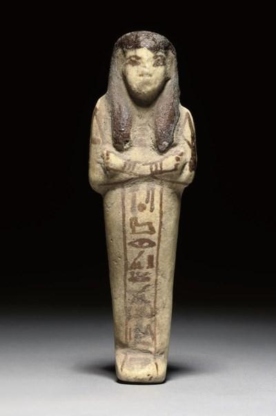 AN EGYPTIAN WHITE FAIENCE SHAB