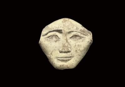 AN EGYPTIAN CREAM 'FAIENCE' MA